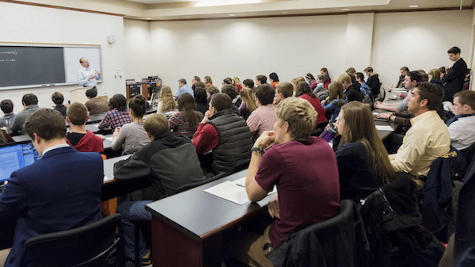 Room full of students listening to a lecture.