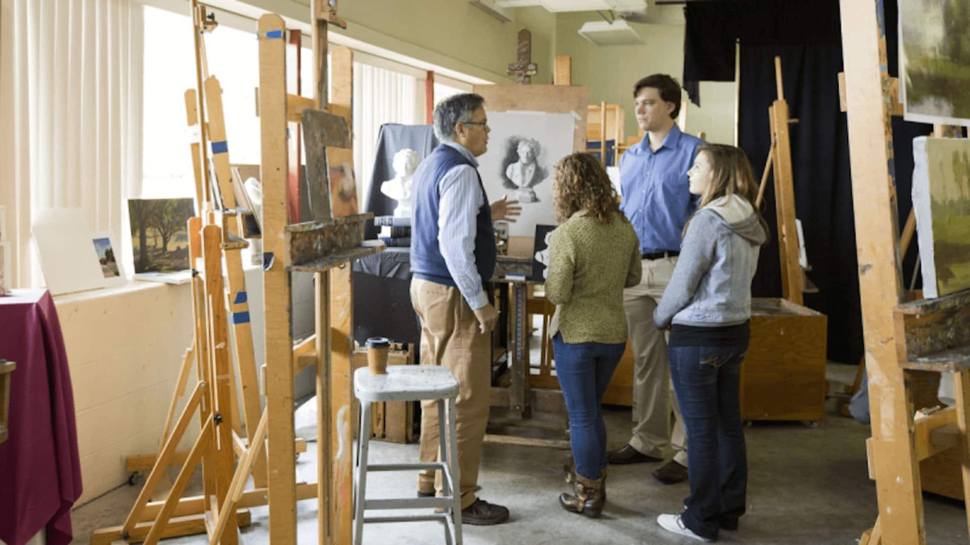 students talking to art professor