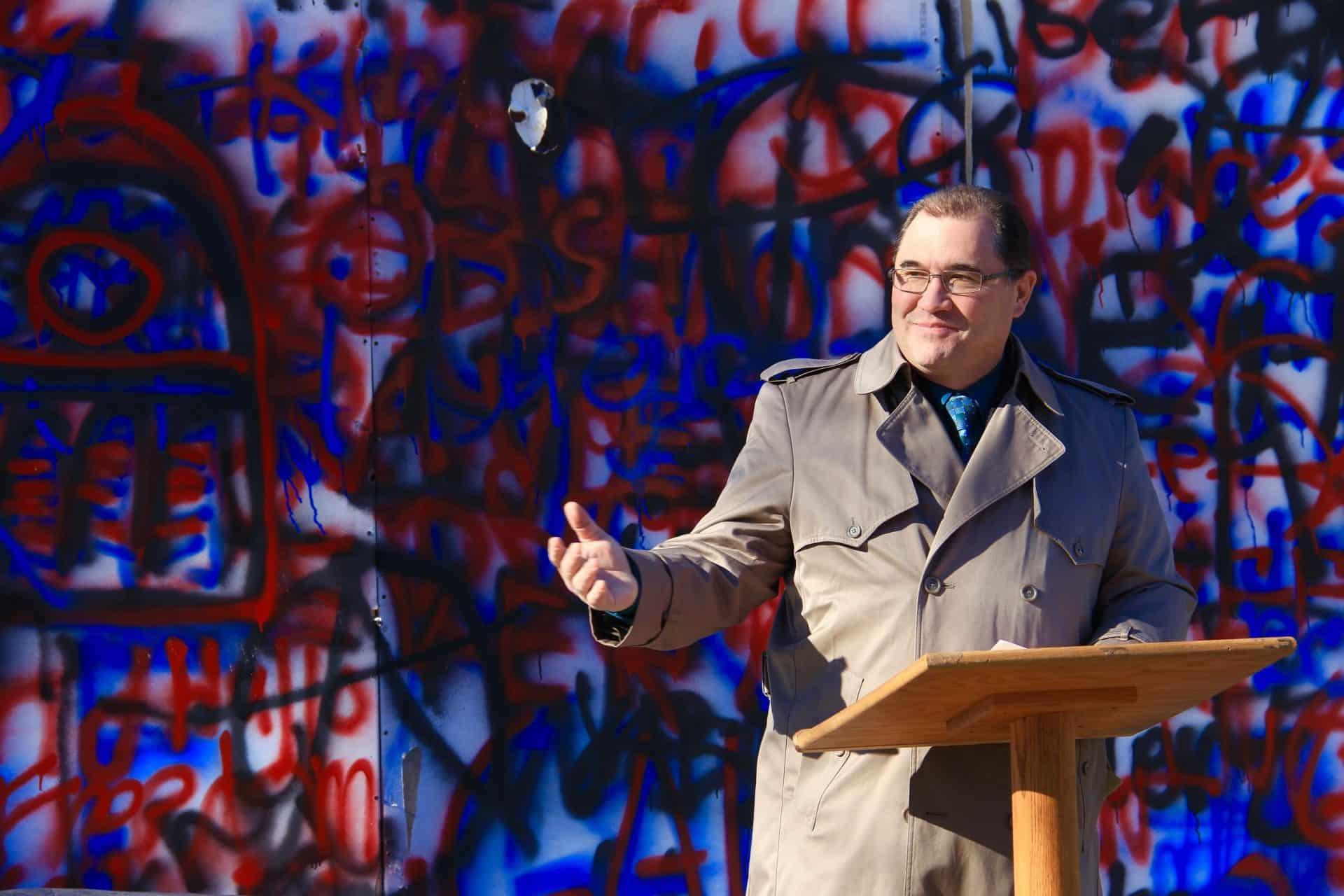 Yaniga at fake Berlin Wall