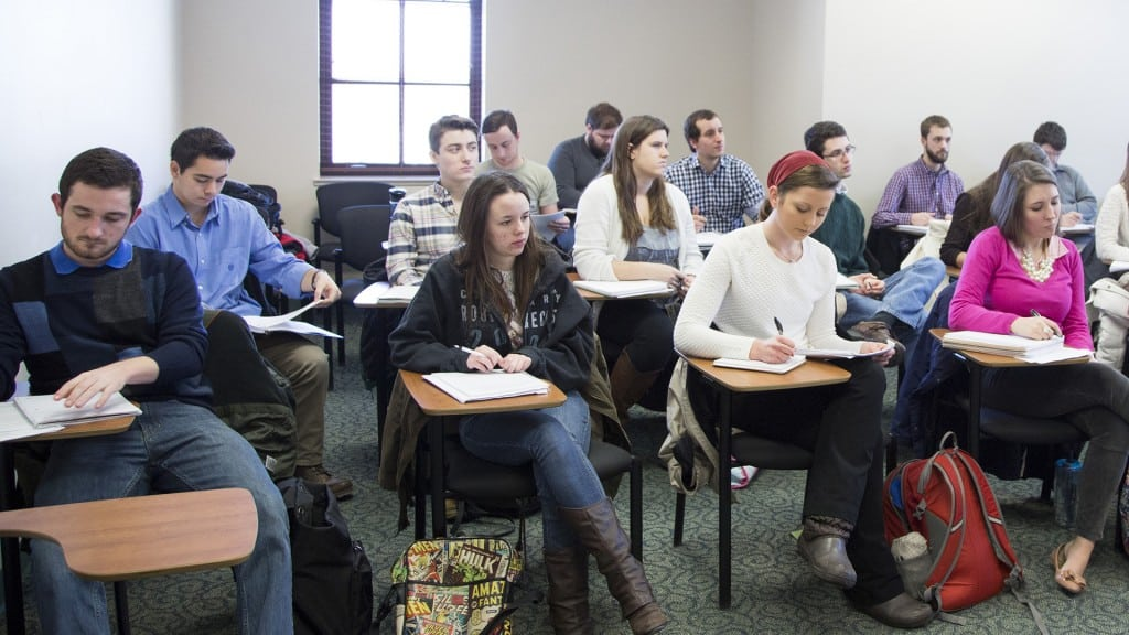 Students taking notes during an Economics class.