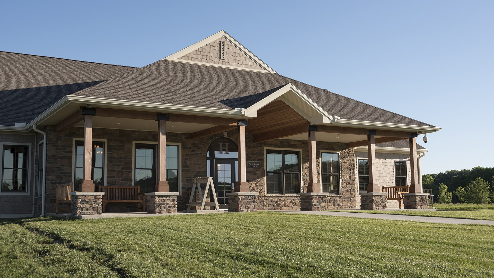 Front exterior of AcuSport Lodge at the John Halter Shooting Sports Center.