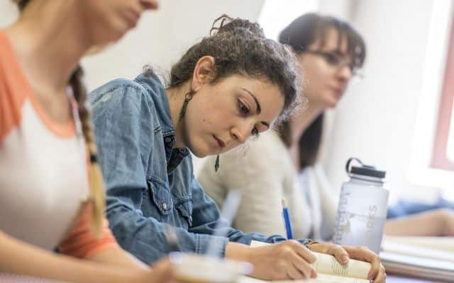 Students taking notes during an English class.