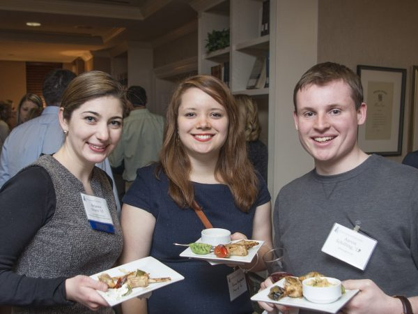 Three alumni attending a reception during Alumni Weekend at the Kirby Center.
