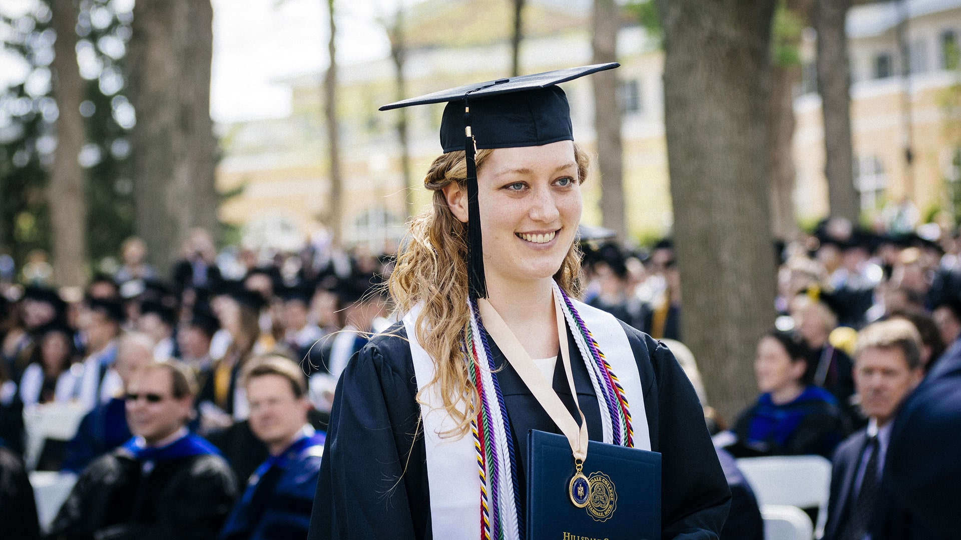 Ellen Roundey in cap and gown during graduation.