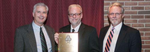 Greg Wolfe presented with Alumni Award