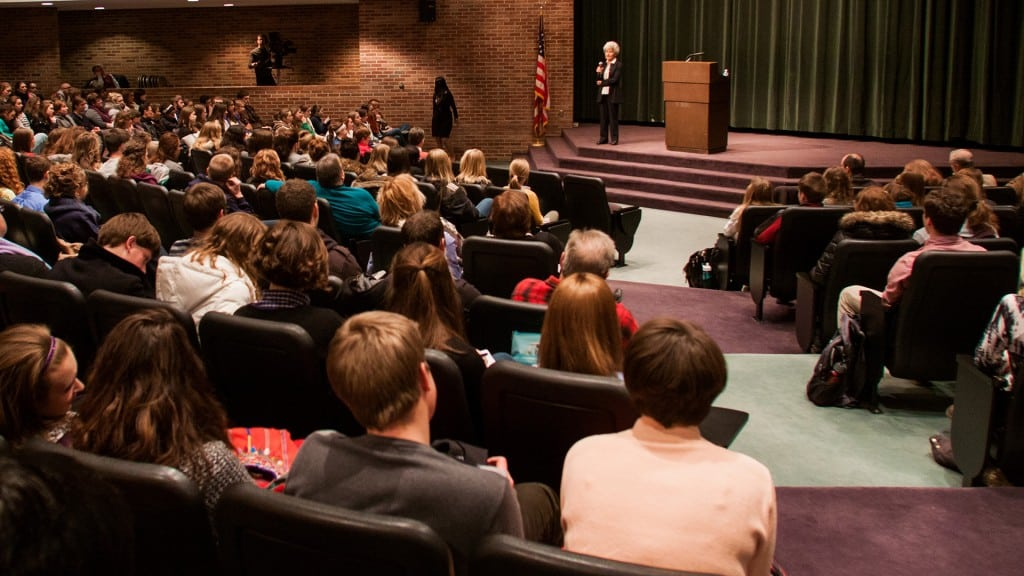Miriam Winters giving a lecture to students in an auditorium.