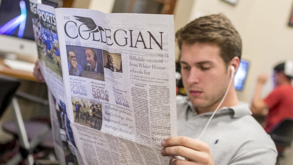 Student reading Collegian