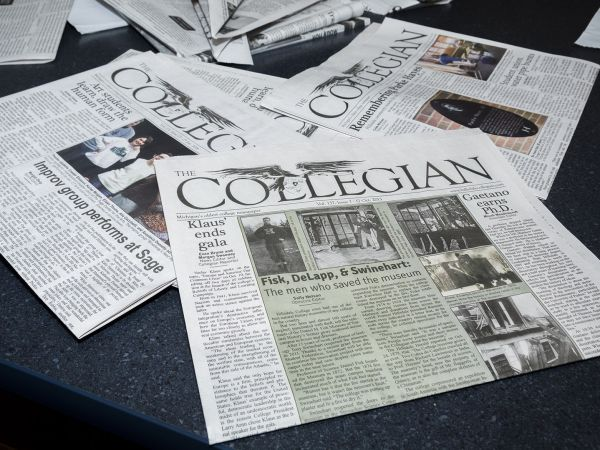 Several Collegian newspapers on a table.
