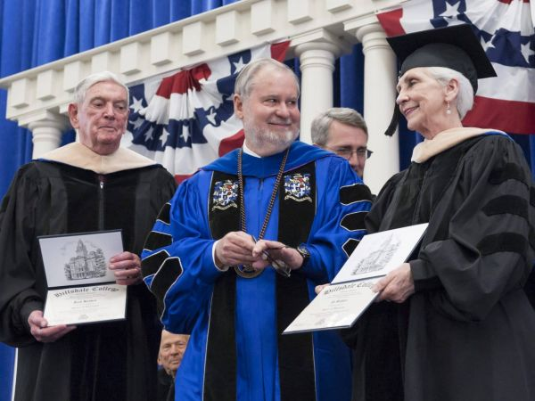 John Babbitt, Larry Arnn, David Whalen, and Joan Babbitt during commencement.
