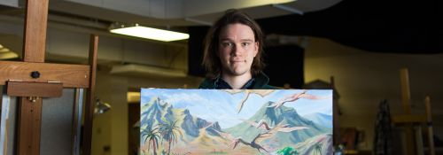 Forester McClatchey with his own artwork conceptualizing dinosaurs.