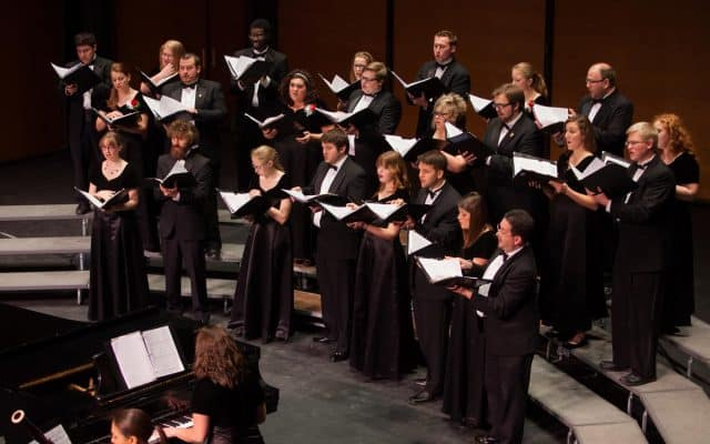 Hillsdale College Chamber Choir singing during concert.