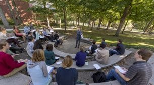 Hillsdale Professor teaching students outside.