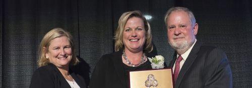 Beth Walker receiving a 2016 Alumni Award from Dr. Arnn.