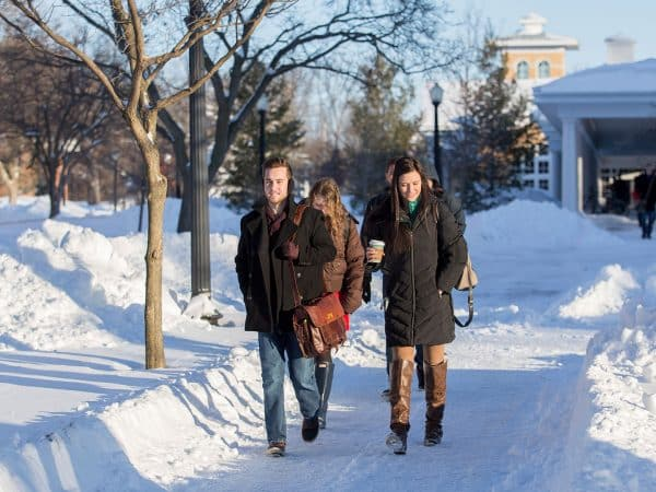 Students walk through snow
