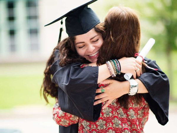 Graduation Girl Hugging Mom
