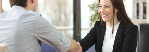man and woman job handshake