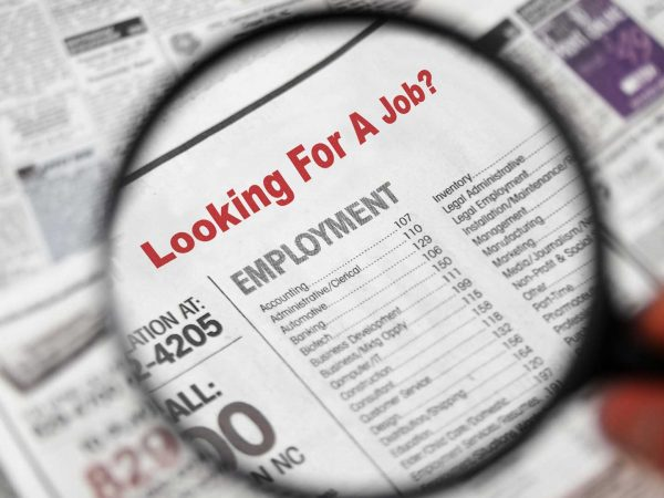 """A newspaper clipping with the words, """"Looking for a job?"""""""