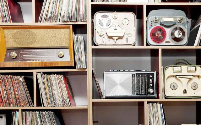 Bookshelf with vintage radios.