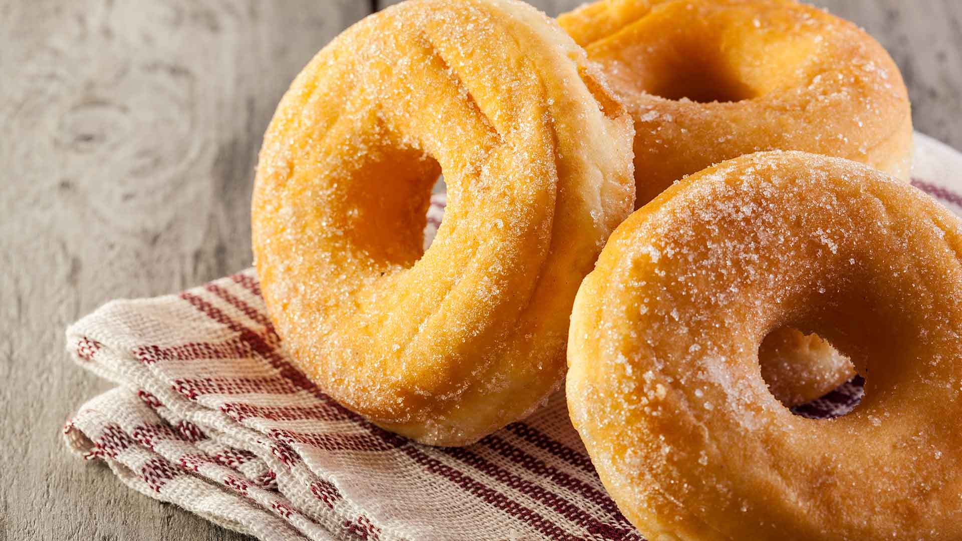 Closeup of sugared donuts.