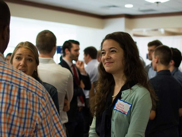 Several Alumni Networking attendees conversing.