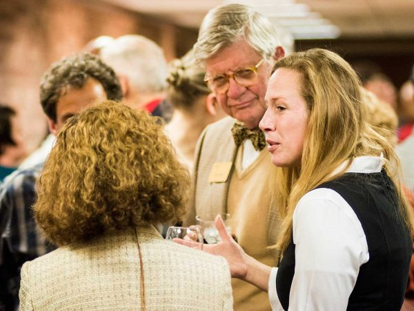 Several individuals conversing during a Career Services meet-and-greet.