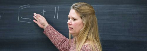 Courtney E. Meyet at chalkboard Nov. 2017