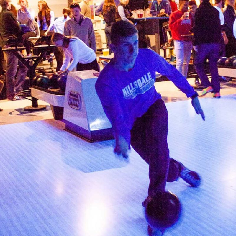 One student bowling.