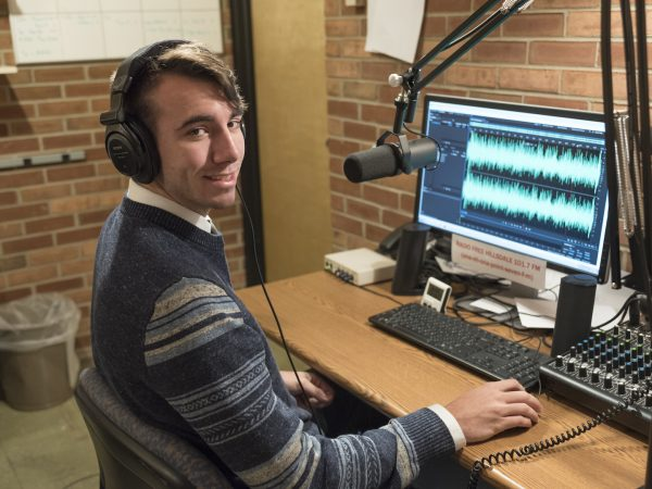 Cole McNeely, '19 at the radio station
