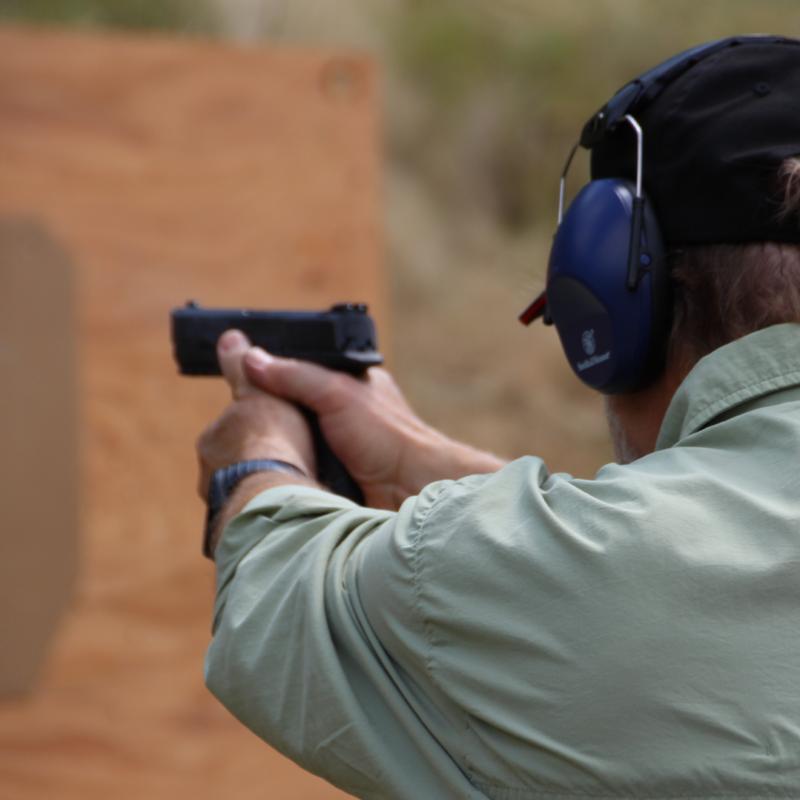 Dave firing a pistol.