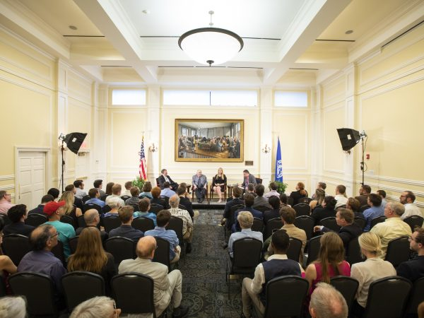 Audience gathered listening to Paul A. Cantor, Beverly Hallberg, and James Taranto.