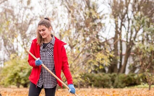 A volunteer raking leaves.