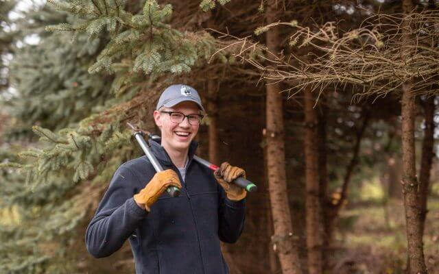 A volunteer with trimming shears.