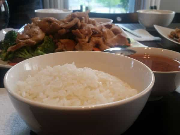 Bowls of rice, stir-fry, and soup.