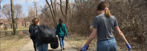 Students picking up trash for community service.