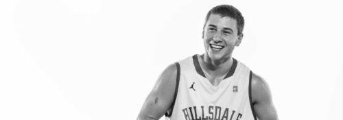 Nate Neveau playing basketball.