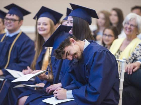 Students laughing at commencement
