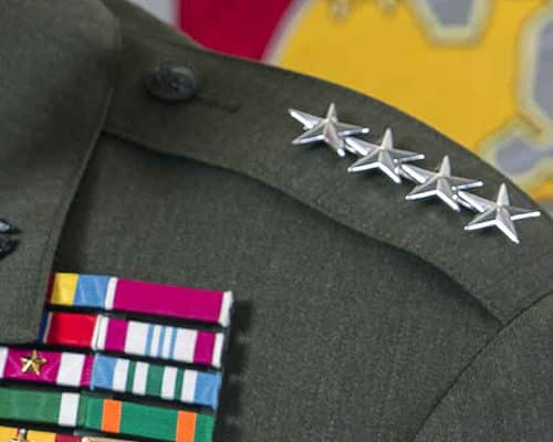 Closeup of a U.S. Marine Lt. Gen. uniform's stars and medals.