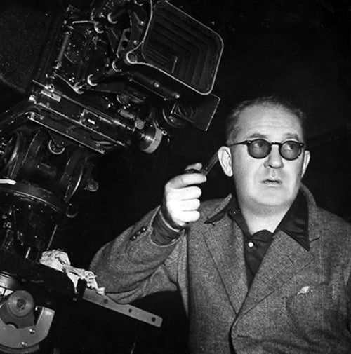 John Ford during movie filming, pipe in hand.