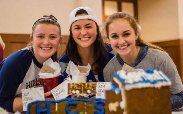 Students showing off their gingerbread house creations.