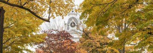 Hillsdale College clock tower through autumn leaves