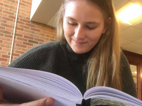 Student Callie Stoub reading a book