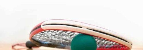 racquetball and racquetball racquet on a racquetball court