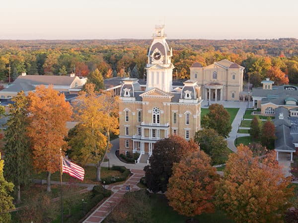 an aerial view of campus with orange and gold foliage