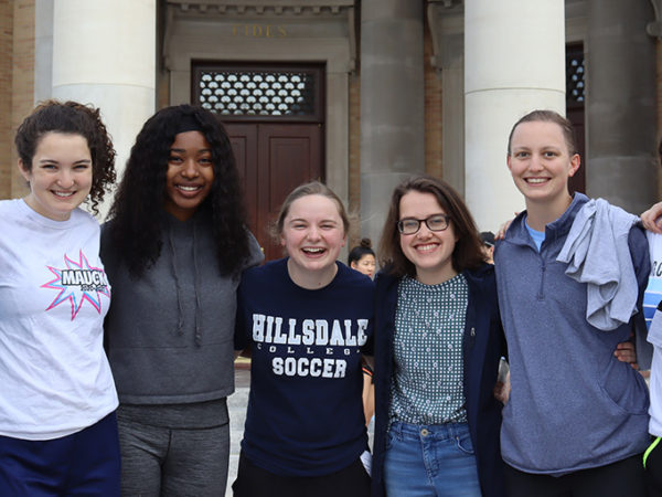 Hillsdale students posing while participating in the Day of Service