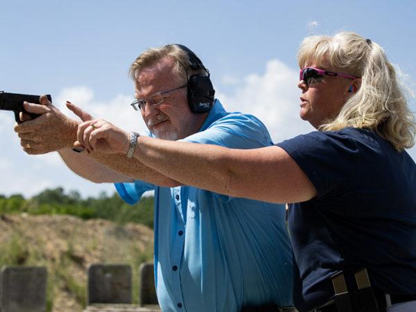 A participant practices with a pistol